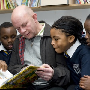 Nick Hornby with children from St Monica's RC Primary School (photo: Miriam Douglas)