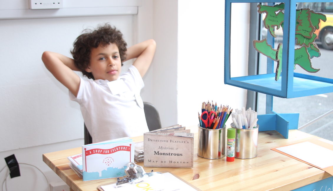 Boy at front desk of embassy