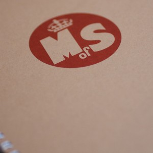 Ministry of Stories logo on a notebook (photo: Alistair Hall)