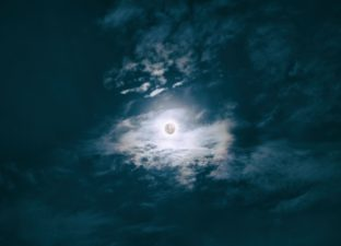 The moon sitting in a dark sky